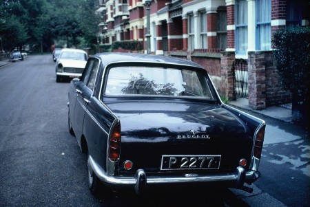 St. Vincent, the rarest of the W set of Windward Islands, seen in London in 1969, and still the only one ever.    The owner had to be stopped and asked, to learn the island of source.    Peugeot 404 - Brumby archive.