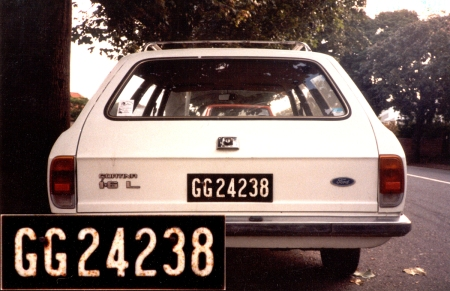 Until 1981, South African Govt. departments were allocated plates from the ' Government garage'.    Here is a Ford Cortina Mk 3 estate car in Grahamstown in those days.    Brumby archive