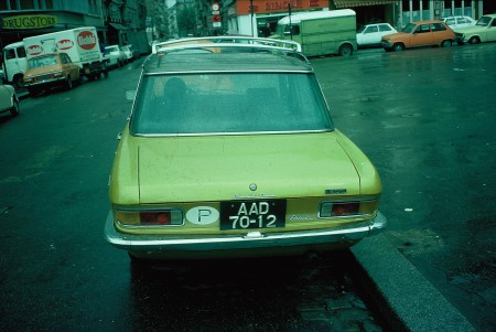a 1976 escapee from the civil war, gat his car to Paris.   Regional code A was for Luanda, the capital.