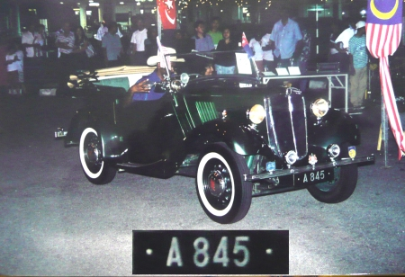 A - Perak state, on a 1935 Morris Eight tourer.