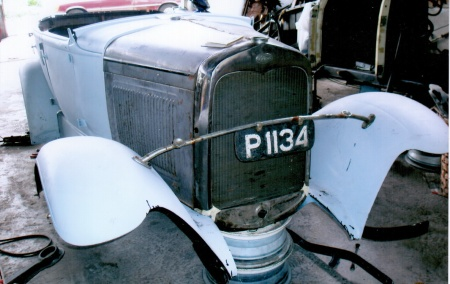 P 1019 - Penang island,  when administered as a Straits Settlement and using the same registration system as mainland Malaya.  Seen here in 2009 Penang on a Ford Model A awaiting restoration.