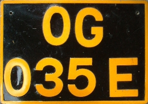 OG...E codes Ake Abeokuta in the 1990s series.  Orange on black was for cargo vehicles.