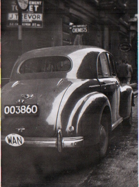 OO 3860 is an unlisted area code, but may be from Abuja (OOA), seen on a 1940s Morris Oxford.   Pemberton Archive