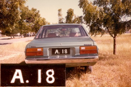 A.18, which would have first been issued in about 1915, is seen on a then-modern Japanese Datsun 120Y, indicating that Anguilla registrations were re-issued when voided.   See also A 14.    The 'A' series had reached the 1400s in Dec. 1981.