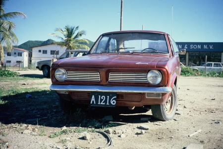 a typical painted woden plates on a Morris Marina, the worst British car ever made.