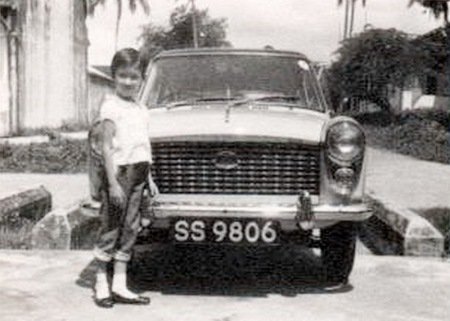About 1960, many British Army, Navy and Air Force personnel served in Singapore and it was a period of very heavy registrations, as most  purchased a car there or duty-free at home, to take out.    This Austin A40 Farina belonged to a Wing-Commander, whose daughter June, modelling here, now dwells in Ottery St, Mary and makes jam for the W.I.     Brumby archive.