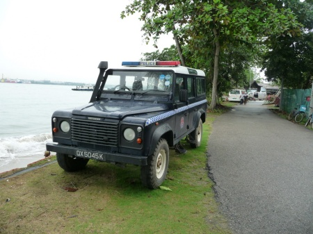 QX 5045 K is a standard Singapore police plate, coded by the QX.    This is one of two allocated to the island - surely an easy posting for the island coppers!      Brumby archive