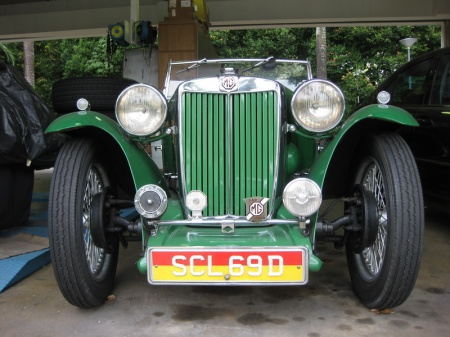 A well-restored MG TC sporting the special, low-tax plates of the approved vintage and veteran cars and bikes in Singapore.    SCL 69 D is a normal registration issue, and it is the plate colour which gives the privileged status.    Brumby archive.