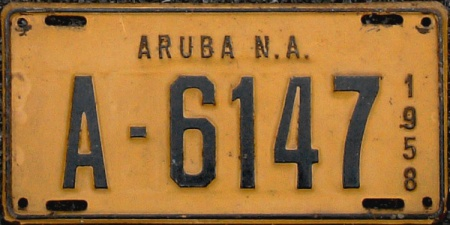 When I saw this, I had to visit the library to find out where 'Aruba' was to be found on an atlas!.    Some weeks after seeing the Ford 100E Anglia at Hyde Park Corner, I saw VXD 44 parked in Fulham from the top of my RT double-decker.     Swiftly dismounting, I hunted the owner, in the sure belief it was the Aruban, recently re-registered in Britain.   It was, and the amused owner handed me one of his plates, which I still value among the most unusual plates in my collection.