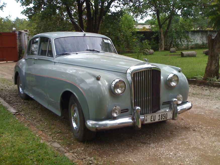 A yet newer adoption of an earlier=series registration is EU 1850, borne on a Bentley S3 from the '60s. EU would originally have been issued on the British design of plate, in white on black, but has been re-issued using the current Zambian format.