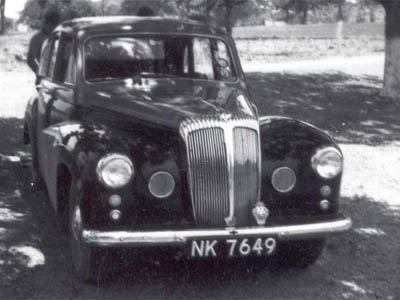 NK 6749 is carried by a Daimler Conquest Century, an unusual car for Africa, one surmises. These used preselector gearboxes - and lots of interior walnut trim! NK=one of the codes for Kitwe.