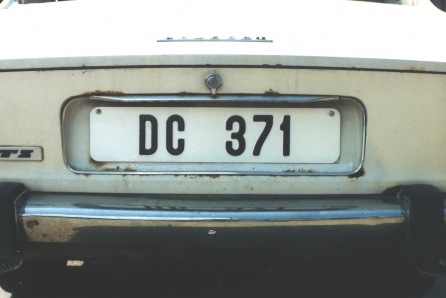 This is thought to be a Rhodesian District Commissioner plate seen on a dumped Peugeot 504 at Kariba airfield in the 1990s. Brumby archive.