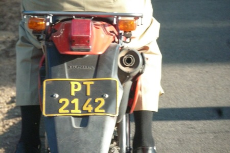 Properly-pressed motor-bike version for police, using an unusual font.