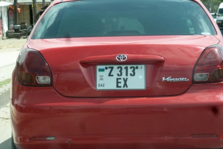 EX is the latest serial to be issued (Nov. 2013)   All vehicle types use the same series, but the plate colour changes according to the vehicle use  - Private (all vehicle types) Taxi, Tourist Taxi, Cargo/public carrier.
