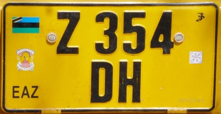 Lorry plates, for carrying goods for hire and reward, use a dark yellow plate with black digits, from the normal registration system.
