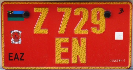 Tourist Taxi using yellow on red pressed plates.