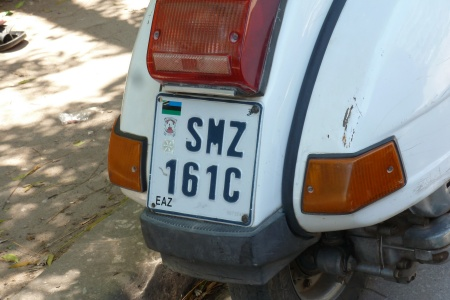 Current government issues have developed to three numerals and a serial letters, presumably because the previous system reached 9999.    There are hundreds of Vespas in Zanzibar - far more than there are light motorcycles, which woud have thought were much more suitable for the poor roads......   SMZ 151 C here/