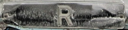 R = Resident.   A Bluemels-manufactured plate for Zanzibar.