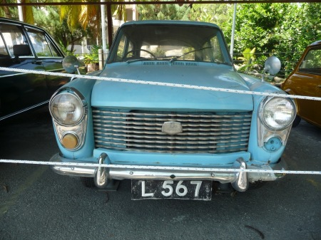 Another Austin, an A40 model, retired to an outdoor museum in Kota Kinabual, Sabah, but sporting 1960s plates from Labuan Island.
