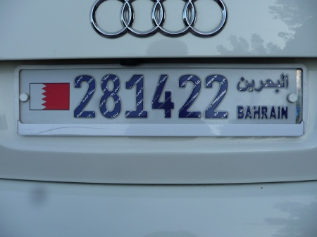Parked nearby, we see the current Bahrein plate, in dark blue on white, with striped figures.      Brumby archive 2014