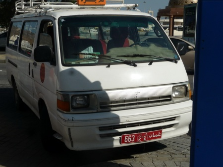 Minibuses with multiple seats, and which can take some cargo, use code KK and are little seen in the main town of Muscat.    Brumby archive 2014
