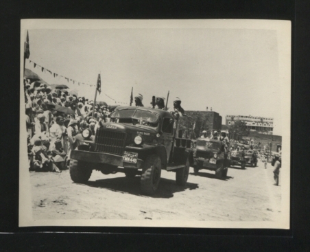 Description: Armed vehicles carrying machine guns manned by HM the Imam's bodyguard. Location: Yemen Date: 1950-1959 Our Catalogue Reference: Part of CO 1069/677 This image is part of the Colonial Office photographic collection held at The National Archives. Feel free to share it within the spirit of the Commons Please use the comments section below the pictures to share any information you have about the people, places or events shown. We have attempted to provide place information for the images automatically but our software may not have found the correct location. For high quality reproductions of any item from our collection please contact our image library