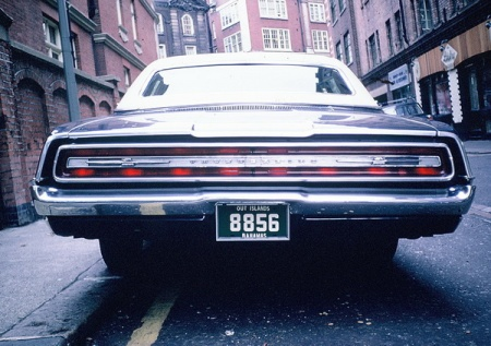 Before each island issued its own plates, they used mainland numeric issues,  often with 'OUT ISLANDS' on the home-made plate, and often on a green background with white lettering.     This is a 1960s picture taken outside Harrods in London during the early 1960s.        Brumby archive c.1962