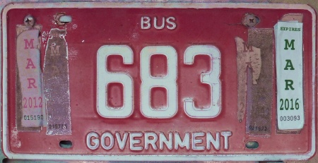 Bahamas buses come in several plate types.   Here is a Government bus, which might be seen on any island, without any differentiation.      683 is seen in Geat Exuma.             Brumby archive 2015.