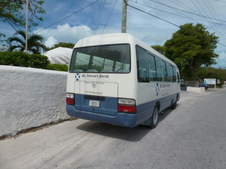 Black-on-white plates are used for private buses, used by churches, schools, clubs etc.     This church-owned bus is seen in Great Exuma.      Brumby archive 2015