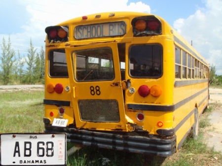 Black-on-white plates are used for private buses, used by churches, schools, clubs etc.     This one is seen in Abaco.      Brumby archive 1986