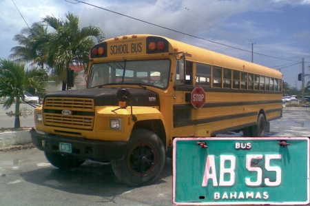 white on turquoise  bus plates are for school buses.   AB codes Abaco island.     Brumby archive 1986