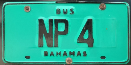 NP 4  --  black-on-emerald plates are for buses used for tourism purposes, (Tour Bus) and use the island codes prefixes.