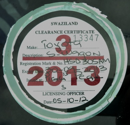 Windscreen-mounted tax discs are used in Swaziland by those who can afford them.     Brumby archive