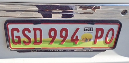 Seen in Cape Town in June 2015, a new series of Swaziland Government plates, emulating the South African red digits for state vehicles.  Swazi plates have always been made for them bu South Africa.   SG is Swazi govt. and PO is for the Police.